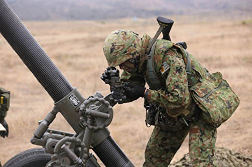 Home Comforts A Japanese Ground Self-Defense Force soldier gets his coordinates during a patrolling exercise as pa by Home Comforts