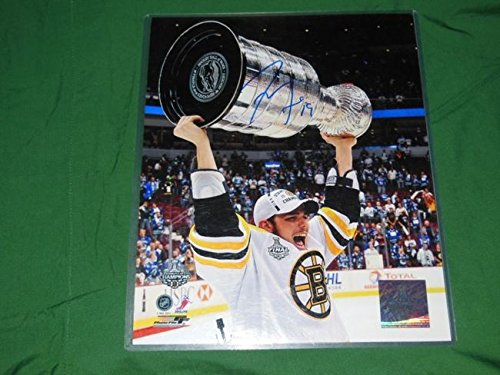 - Boston Bruins Tyler Seguin Autographed 8x10 Photo Holding Cup