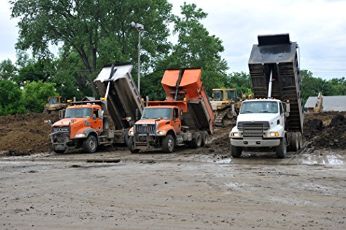 Home Comforts Framed Art Your Wall Dump Trucks Filled a Mixture Dirt Clay Dump Their Loads in Front The levee on Broadwa 10x13 Frame