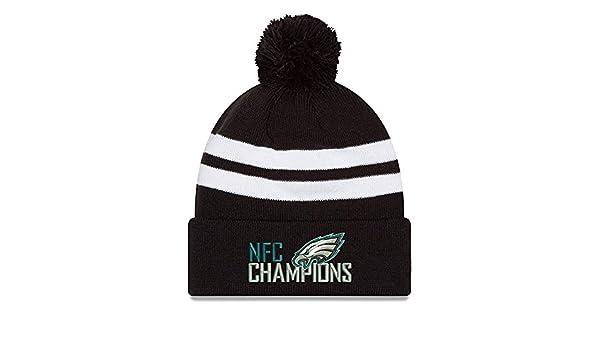 8a10b964fb5 Amazon.com   Philadelphia Eagles New Era 2017 NFC Champions Top Stripe Knit  Hat Black   Sports   Outdoors