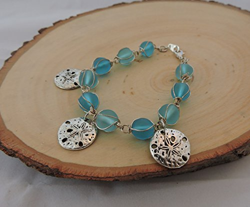 Ocean blue glass bead and sand dollar bracelet from TJs Crafts And More