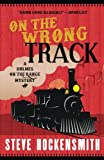 On the Wrong Track: A Holmes on the Range Mystery (Holmes on the Range Mysteries) (Volume 2)
