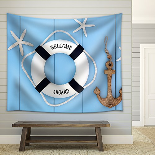 Decorative lifebuoy anchor and starfish sea shells over wooden blue background Fabric Wall
