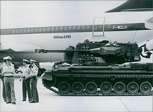 (Vintage photo of Soldiers standing beside the anti-aircraft tank39;Gepard.39; 1982.)
