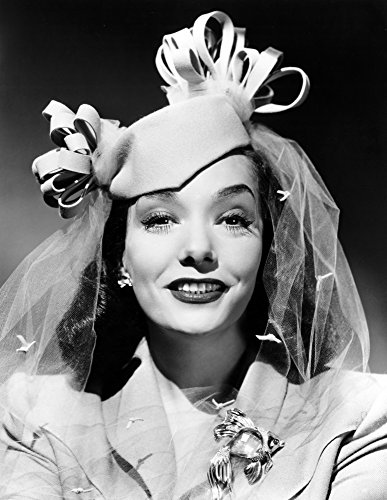Mexican SpitfireS Baby Lupe Velez In A Beige Felt Pillbox And A Gold Brooch Set With Aquamarine Rubies And Diamonds Ph Ernest A Bachrach 1941 Photo Print (16 x -