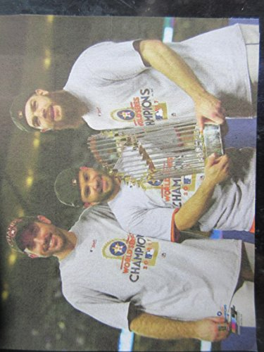 JUSTIN VERLANDER -JOSE ALTUVE - DALLAS KUECHEL HOUSTON ASTROS POSE WITH THE 2017 WORLD SERIES CHAMPIONSHIP TROPHY PHOTO MOUNTED WITH PLASTIC COVER ON A