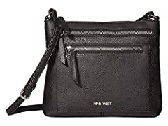 Pull your whole look together with the help of Nine West® Coralia Ailani Crossbody bag. Bag made from man-made materials. Zip closure. Cross-body strap. Exterior offers two zip pockets with brand logo on front. Interior offers a single zip po...