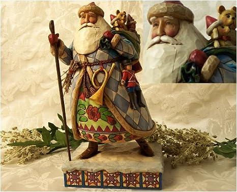 Amazon.com: jim shore santa bringing christmas joy: home & kitchen