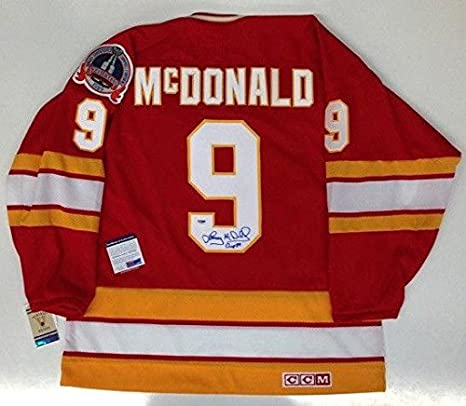 a6758a563 Amazon.com  LANNY McDONALD SIGNED CCM CALGARY FLAMES 1989 STANLEY CUP JERSEY  COA - PSA DNA Certified - 5  Sports Collectibles