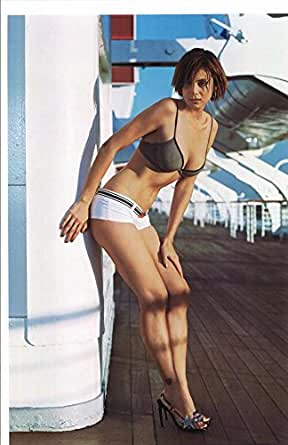 sexy catherine bell standing in bra and shorts on ship