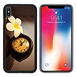 MSD Premium Apple iPhone X Aluminum Backplate Bumper Snap Case Vintage wooden Thai desk clock on a table with plumeria flower IMAGE 25550613