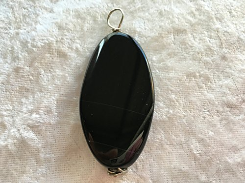natural black onyx gemstone carved twisted oval pendant ()