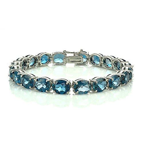 Sterling Silver London Blue Topaz 9x7mm Oval Tennis Bracelet by Ice Gems