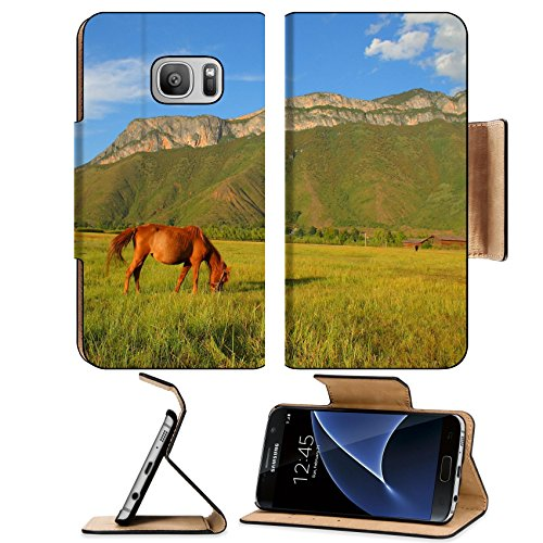 Luxlady Premium Samsung Galaxy S7 Flip Pu Leather Wallet Case IMAGE ID: 34361930 Brown horse eating grass on the pasture with the beautiful Gemu holy mountain in the - Hills T Chino Mobile