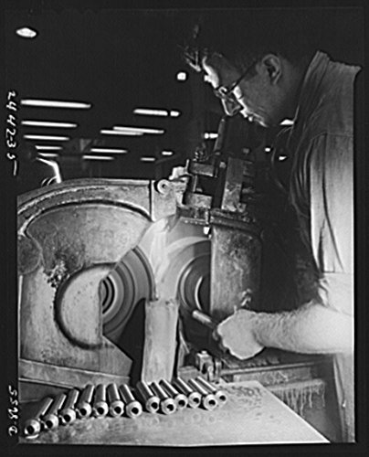 1942 Photo Conversion. Farm implements to gun parts. Prior to conversion to the production of military equipment, a centerless grinder was used by a Midwest farm implement manufacturer for grinding be
