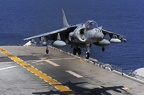 Posterazzi East China Sea March 5 2012-An AV-8B Harrier Jet Lands on The Flight Deck of The Forward-Deployed Amphibious Assault Ship USS Essex. Poster Print (34 x 22)