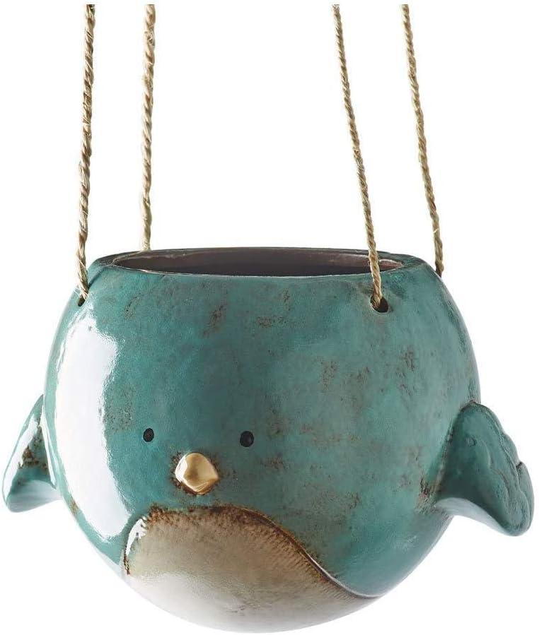 Tiny earthenware blue bird pendant