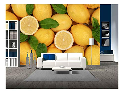 (wall26 - Group of Fresh Lemons with Leaves and Sliced Lemons Forming a Background - Removable Wall Mural | Self-Adhesive Large Wallpaper - 66x96 inches)