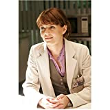 House M.D. with Jennifer Morrison as Dr. Allison Cameron Seated in Lab Coat 8 x 10 Photo