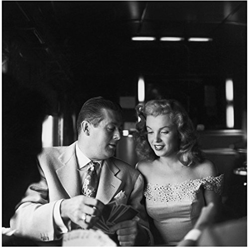 Marilyn Monroe Seated and Smiling Next to Man Playing Cards 8 x 10 Inch Photo