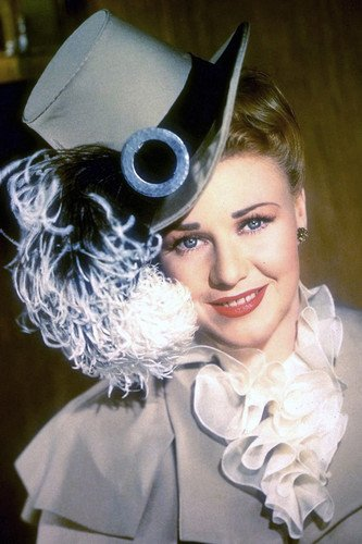Ginger Rogers in Magnificent Doll smiling in gray feathery hat/outfit 24x36 Poster - Magnificent Doll Poster