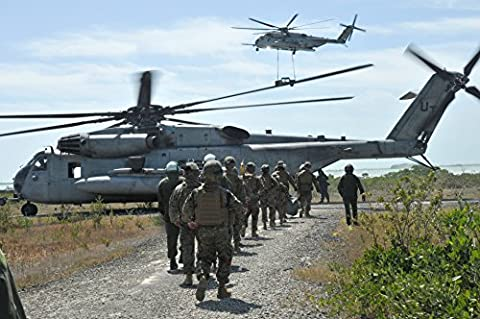 Marine Corps aviators with Heavy Marine Helicopter Training Squadron (HMHT) 302 prepare to board a - 302 Training