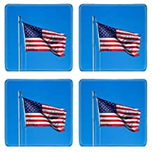 MSD Natural Rubber Square Coasters IMAGE 23128957 A weathered American flag waving in the wind on a flagpole against a blue sky