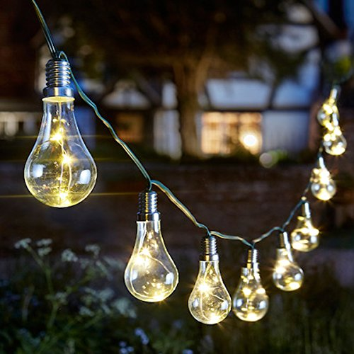 Solar outdoor string lights 10 bulbs with starry fairly lights inside.