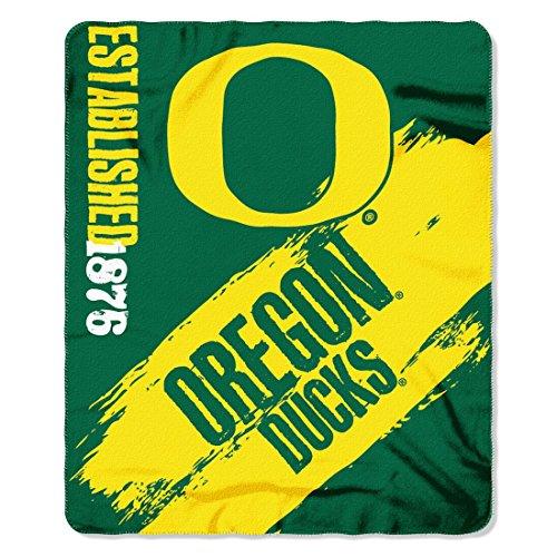 (The Northwest Company 1 Pc, Oregon Ducks Blanket 50x60 Fleece College Painted Design, 100% Polyester, Big Team Logo & Graphic Background, Decorative Binding Around Edges, Machine Washable)