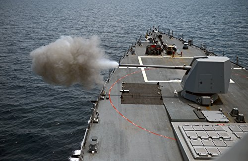 Home Comforts The guided-missile destroyer USS Momsen (DDG 92) fires its 5 gun during a bilateral gun exercise wi by Home Comforts