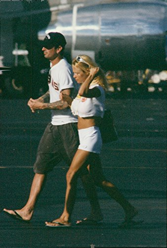 Vintage photo of Pamela Anderson and her husband Tommy Lee, drummer of rock band Motley Crue, photographed during their vacation in Bora Bora, ()