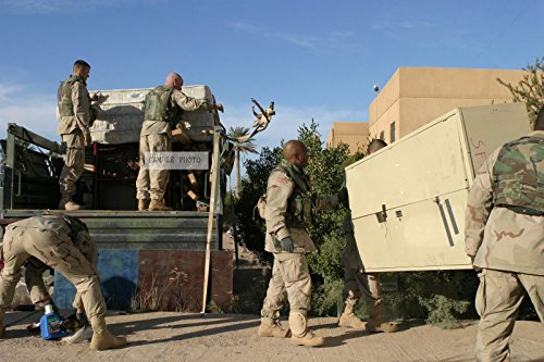 Photo U.S. Army Soldiers with the 1ST Battalion, 503rd Regiment, 2nd Division, unload a supplies from a truck near the town of Ar Ramadi, Iraq, during Operation Al Fajr, in support of Operation IRAQI FREEDOM on Dec. 3, 2004.(U.S. Marine Corps official photo by Lance CPL. Andrew D. Young) (Released), 12/03/2004
