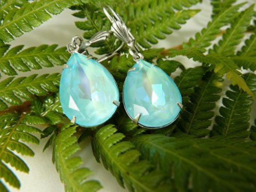 Ultra Light Turquoise Swarovski Crystal Pear-Shaped Fancy Stone Drop Earrings, with Antique Silver Plated Leverback earwires.