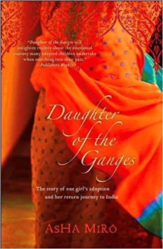 "Rectangular book cover depicting the rich, orange fabric of a sari dress with bright blue details and embroidery. Only the middle of the body is shown; no head of feet. The background is a slightly more muted orange tone, with shadows. The title ""Daughter of the Ganges"" and Asha Miro's name are centered towards the bottom of the cover."