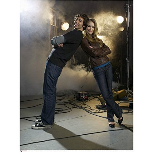 Chuck (TV Series) Zachary Levi as Chuck Bartowski on Set with Yvonne Strahovski Leaning 8 x 10 inch photo