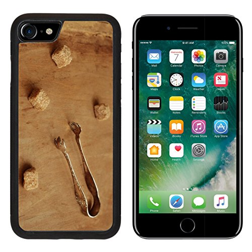 MSD Premium Apple iPhone 7 Aluminum Backplate Bumper Snap Case IMAGE 30179406 Vintage silver plated sugar tongs and pieces of cane sugar over aged brown background ()