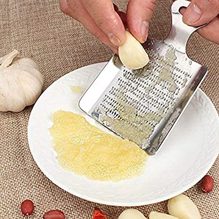 Ipop Retail Stainless Steel Garlic and Ginger Grater, Small(Silver) Graters & Slicers at amazon