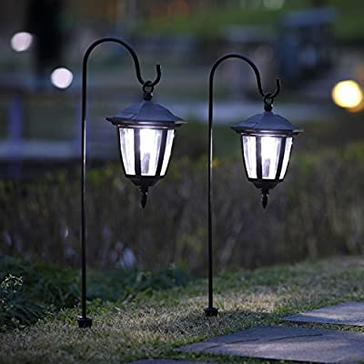 MAGGIFT 26 Inch Hanging Solar Lights Dual Use Shepherd Hook Lights with 2 Shepherd Hooks Outdoor Solar Coach Lights, 2 Pack - Solar powered-- powered by free solar energy and no electricity required. The solar panel supports long-term operations. Package includes 2 lights, 2 shepherd hooks. Two installation modes--easy to install, just hang in the branches or push the stake on the unit down into soft earth. There's an INSULATION TRIP on the light cover, turn 30 degrees counterclockwise to separate the light, make sure TAKE INSULATION TRIP OUT before charging. Decorative--suitable for outdoor use, add a charming ambience, perfect use on pathways, decorate your garden, porch or yard. 4 lumens, IS DESIGNED FOR DECORATION, MAYBE NOT BRIGHT ENOUGH BUT GENTLE. - patio, outdoor-lights, outdoor-decor - 51ouXa2OtNL. SS400  -