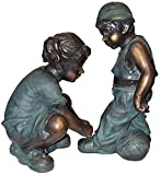 Alpine Girl Fixing Boy's Shoe Lace Statue