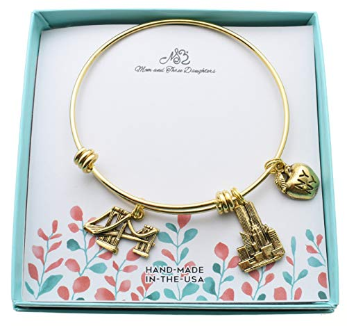 New York City bangle bracelet in gold stainless steel with gold plated pewter charms. Brooklyn Bridge. World Trade Center, Big Apple.