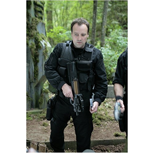 David Hewitt 8 inch x 10 inch PHOTOGRAPH Black Jumpsuit Bulletproof Vest Holding Gun Surrounded by Trees Mid