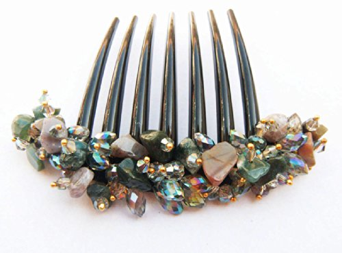 French twist hair comb Ornamented along the top of the heading with Stone