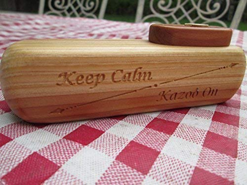 Handmade Wooden Kazoo with the custom saying: Keep Calm Kazoo On . Each Kazoo is truly unique! This is an instrument that you can be proud to keep as your own or to give as a gift.