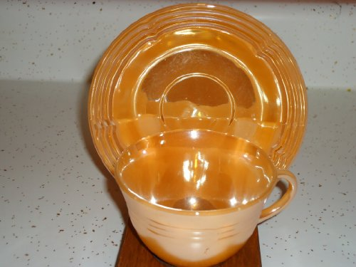 (Fire King Peach Luster Ware Cup & Saucer Pair)