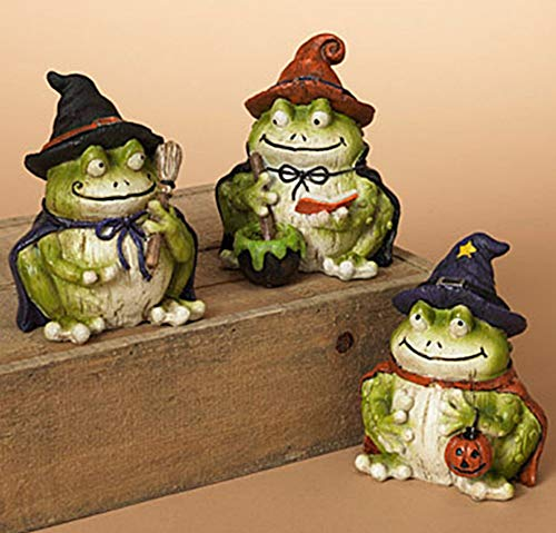 Gerson Set of 3 Wood Carved Style Resin Halloween Frogs Dressed in Witch Costumes]()