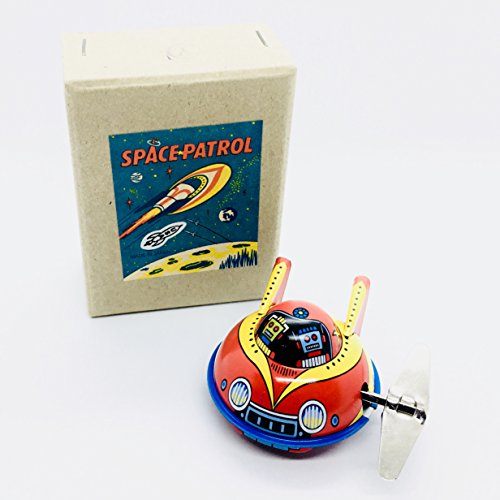 Rocket USA X-7 Yellow Space Patrol Flying Saucer 2004 Big Key Wacky Wind-Up 2 Inch Tin Toy]()