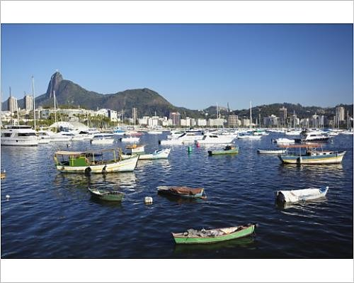 Photographic Print of Boats moored in the harbour with Christ the Redeemer statue in background,