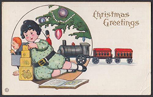 Christmas Greetings postcard 1910 child under tree toy train & blocks