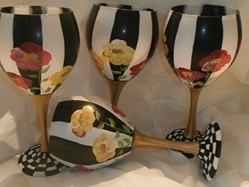 Hand painted Red and Yellow poppies. Painted with black and white stripes. Gold Stem and checked base. This set is so pretty. Great gift. Great set. usa. Set of 4 goblets.. 20 ounces each.