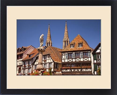 Framed Print of Virgin Mary statue, homes and church towers in Obernai, Alsace Bas-Rhin France by Fine Art Storehouse